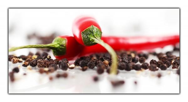 Spritzschutz Pepperoni auf Pfeffer